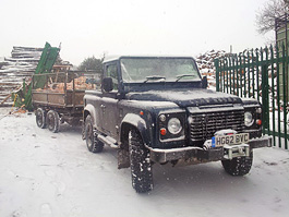 log delivery land rover winter snow